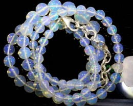57.1CTS ROUND OPAL BEAD STRAND FOB-1074