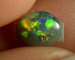 0.30CTS BLACK OPAL - MULTI-COLOUR GEM, SAND SPOT ON TOP - N4 - ID:20698