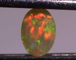 0.60 ct $1 NR Beautiful Multi Color Welo Facet Opal