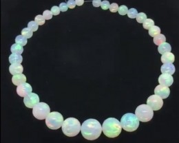 280.20ctw AAA Gem Quality 9-16mm Ball Shape Welo Ethiopia Opal Bead Strand.