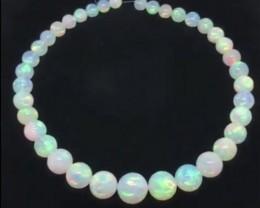 280.20ctw AAA Gem Quality 9-16mm Ball Shape Welo Ethiopia Opal Bead Strand.