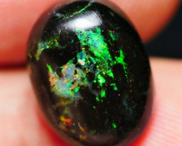 3.65 CRT BEAUTY BRIGHT METTALIC MULTICOLOR WOOD FOSSIL INDONESIAN OPAL