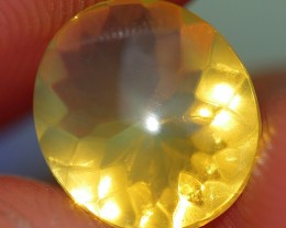 1.05 CRT FIRE OPAL CLEAR BASE FACETED YELLOWISH COLOR INDONESIAN OPAL
