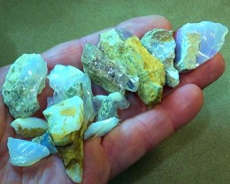 331.00 cts Slovakian HYALITE MILK 15 pcs opals N8,9