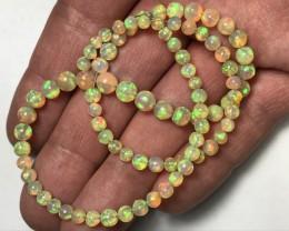 AAA Welo Ethiopia Opal Ball Bead Strand. 4-7mm. 52.40ctw