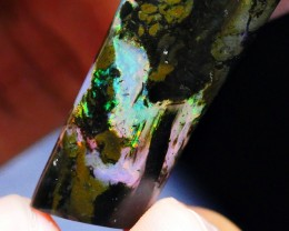 23.75 CRT WOOD OPAL LOVELY BRIGHT PLAY COLOR INDONESIAN OPAL