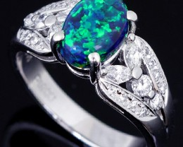 Beautiful black opal stone and diamonds set in platinum ring