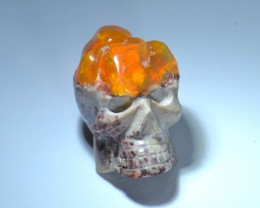 80CT UNIQUE SKULL CARVED MEXICAN FIRE MATRIX OPAL