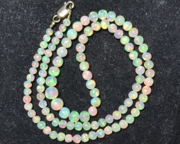 18kt Clasp AAA Welo Ethiopia Opal Ball Bead 19inch Strand. 5-8mm. 54ctw