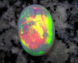 10.25ct HIGHEST QUALITY BRILIANT COLORS ROLLING FLASHFIRE PATERN OVAL OPAL