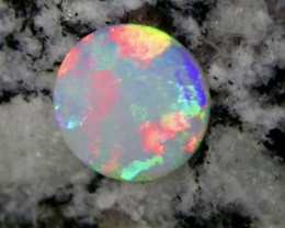 3.27ct EXTR BRIGHT FULLY SATURATED MULTI PATERN ROUND OPAL