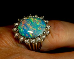 Once-in-a-lifetime statement ring of solid Boulder Opal with halo of White Sapphire.   Solid White gold.  From opal ring designer Amy Klitsner.