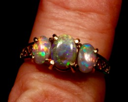 Triple solid black opal engagement ring with filigree design on band.  14K solid yellow gold.  From opal ring designer Amy Klitsner.