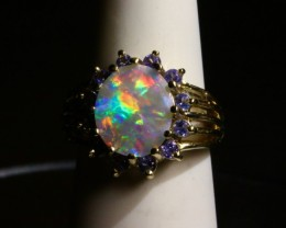 Semi Black Australian Opal Tanzanite Halo Engagement Ring.