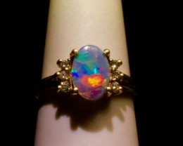 Vibrant Flashy Black Opal engagement ring with 6 SI-1 diamonds. Solid Yellow Gold. Created by opal ring designer Amy Klitsner.