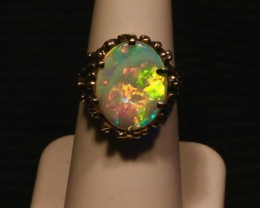 Spectacular large Crystal Opal ring in 14K solid yellow gold from Opal ring