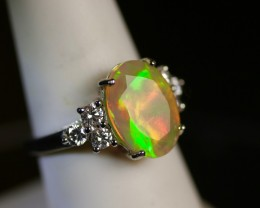 Faceted Ethiopian opal engagement ring with VS-1 White diamonds.  18ct Whit