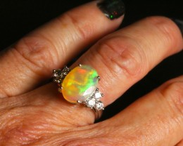 Stunning Faceted Ethiopian opal engagement ring with VSI-1 white diamonds.  18ct Solid White Gold.  Created by opal ring designer Amy Klitsner.