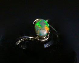 "Black opal engagement ring with diamond band.  I call this my ""French Twist design"". Created by opal ring designer Amy Klitsner."