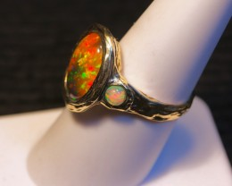 """Sunset orange Ethiopian opal ring in solid yellow gold. """"Organic texture"""" to the metal. Created by opal ring designer Amy Klitsner."""