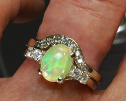 Beautiful Ethiopian opal engagement ring set with matching diamond wedding band. Created by opal ring designer Amy Klitsner.