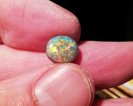 2.65 cts Natural solid black opal with multiple sparkling gem fire