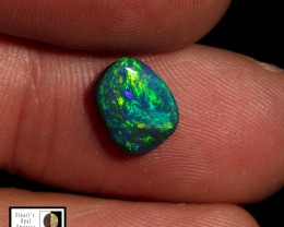 1.25 carat Lightning Ridge black opal - Super swirling fire pattern