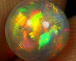 1.40cts Strong Yellow Orange and Rainbow Fire Natural Ethiopian Welo Opal