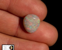 5.20 carat Olympic white base opal, red blue green fire pattern