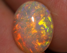 3.08 CT  RED BLUE FLASH!!!MULTI RAINBOW ETHIOPIAN OPAL-AE302