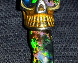 39.30 CRT HALLOWEEN AUCTIONS SKULL PENDENT WITH GORGEOUS WOOD OPAL FOSSIL