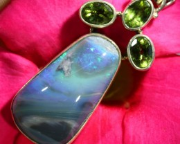 49.75 CTS BLACK OPAL PENDANT IN SILVER WITH PERIDOT [SOJ6481]