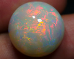 11.75 CRT GORGEOUS ROUND BROAD STRIPE FIRE PLAY COLOR WELO OPAL-