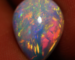 2.48 CT 12X9 MM RED BLUE FLASH ! BEAUTIFUL WELO ETHIOPIAN OPAL-JA277