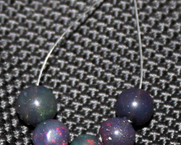 3.20 Crts Natural Ethiopian Welo Smoked Opal Balls Demi Strand 37