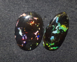20.00 CRT ROLLING FLASH PLAY COLOR INDONESIAN OPAL WOOD FOSSIL