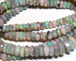 49.20 CTS  L. RIDGE DARK BASE OPAL FACETED BEADS STRAND  TBO-9256