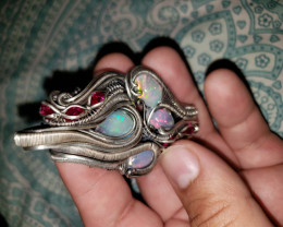 Welo opal and Ruby Silber Pendant