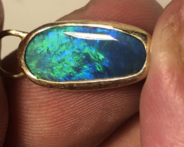 14k gold pendant with solid black opal