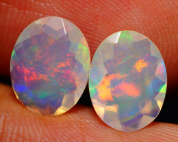 2.42CT 10X8 MM BROADFLASH FIRE!! ETHIOPIAN FACETED OPAL PAIR -ECF629