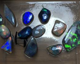 28ct Lightning Ridge Opal Rubs Parcel. 12 pieces