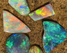 38.70 carats of Bright crystal and Black opal rubs