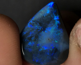 Bright solid black opal from lightning ridge. Night shade blues