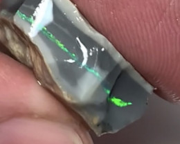 VIDEO- BLACK SEAM OPAL ROUGH TO CUT # 2577