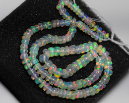 21.00CRT BRILLIANT BRIGHT BEADS AND STRAND WELO OPAL -