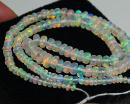 21.30CRT BRILLIANT BRIGHT BEADS & STRANDS WELO OPAL -