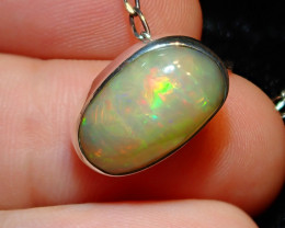 12.29ct Natural Ethiopian Welo Opal .925 Sterling Silver Pendant