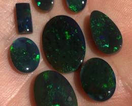 22.8cts green on blacks