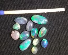 12 Black Opals -  Approx 6 Carats