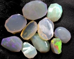 NR PARCEL10  RUBBED  CRYSTAL OPALS  20    CTS     RD302